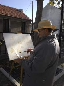 le peintre José Milheiro dessine l'église de Montigny les Cormeilles